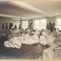 Women factory workers hand sewing canvas at Waring & Gillow's White City factory, 1914-1918. | City of Westminster Archive Centre