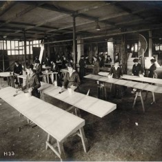 Women workers painting wing sections at the Alliance Aeroplane Company Ltd, Cambridge Grove. | Hammersmith and Fulham Archives