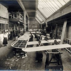 Women workers engaged in the construction of wing sections at the Alliance Aeroplane Company Ltd, Cambridge Grove. | Hammersmith and Fulham Archives