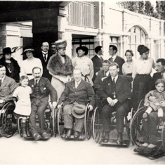 Visit of Queen Mary and Princess Mary to War Seal Mansions, with a group of ex-servicemen in wheelchairs, 5 Jun 1919. | Hammersmith and Fulham Archives