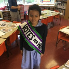 A pupil wears a Votes for Women sash | Westminster Archives