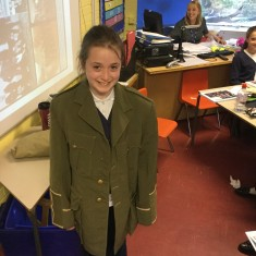A pupil wears a military jacket replica from a soldier's uniform during WW1 | Westminster Archives