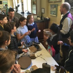 Children looking at artefacts from the First World War | Westminster Archives