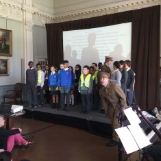 Children from the audience join the soldiers as they prepare to 'go over the top' to fight   Westminster Archives