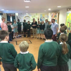 The children rehearse the songs for
